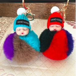 Sleeping baby doll - keychain with fur pompom
