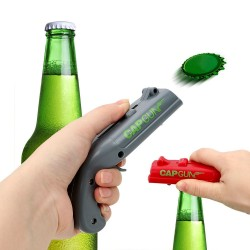 Gun shaped bottle opener - spring catapult